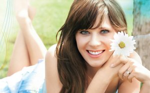 Zooey Deschanel posing with a flower.