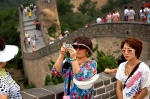 Women pose for a photo at the Badaling Great Wall, outside Beijing, China.