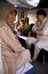 Muslim women chat in a train from Beijing to Chengdu, China, June 2010.