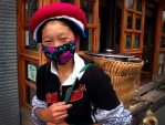 Woman working in Lijiang, Sichuan Province, China.