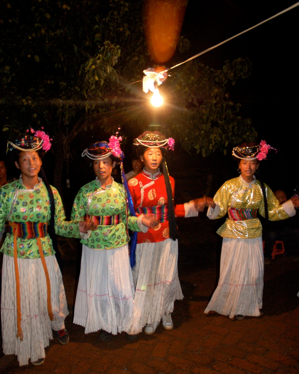 Women and girls perform their traditional dance from Lugu Lake
