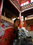 A woman carries cement in a temple in Litang, Sichuan Province.