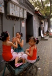 Girls playing in Nanluoguxiang, a hutong near Houhai, Beijing, China.